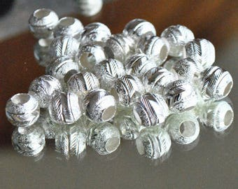 Shiny silver metal engraved aluminum beads