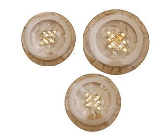 Resin buttons encrusted gold beads transparent effect