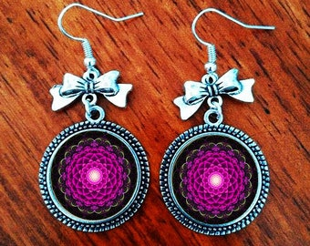 A pretty pair of earring with a glass cabochon 16 mm mandala