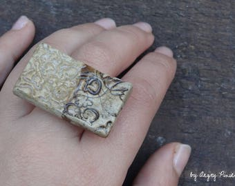 Rectangular ceramic ring with embossed floral pattern