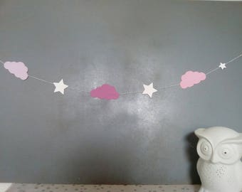 Garlands of pink clouds and white stars