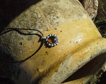 Necklace with its silvery balls winter sun