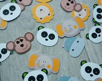 animal theme table confetti in the jungle