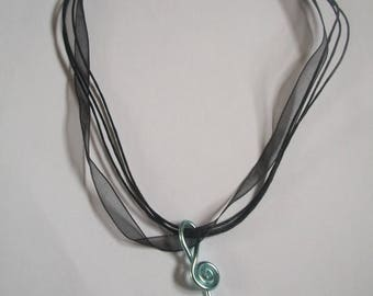 Cord with treble clef pendant
