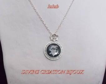Necklace 'fleur de lis' on black background, Pocket Watch