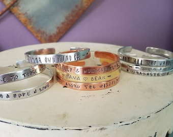 metal stamped jewelry/bracelets