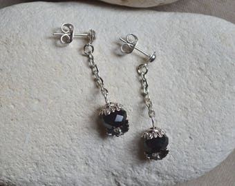 Silver earrings with faceted black beads
