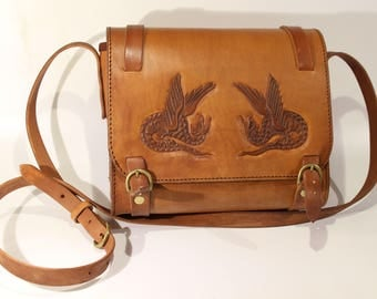 handcarved leather bag with medieval dragons