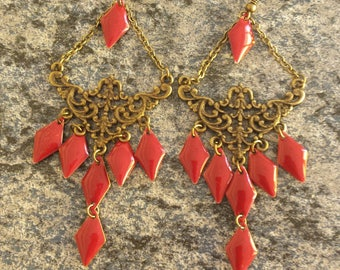 Beautiful bronze earrings and brick red sequins