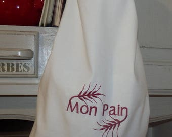 white cloth with red embroidery bread bag