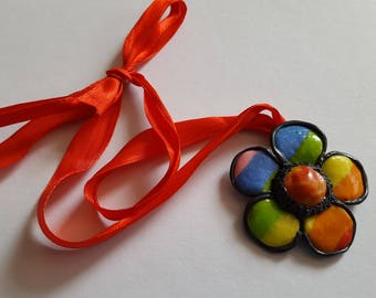 Hand crafted colourful Rainbow flower pendant. Made from polymer clay with a red ribbon necklace.