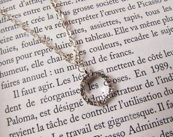 The silver metal rhinestone pendant necklace