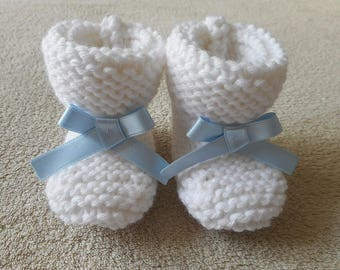 Sky blue satin bow and white wool baby booties.