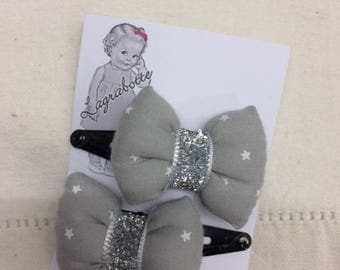 set of 2 clips with liberty bow first gray stars, silver glittery Ribbon