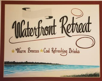Waterfront Retreat sign