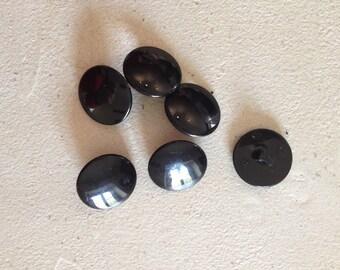 Old black buttons set