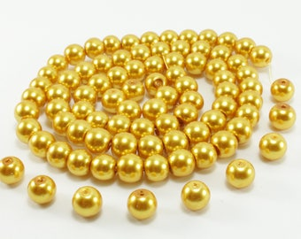 30 yellow glass pearl beads approximately 8mm