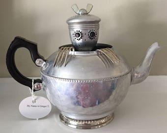 Metal teapot monster/alien/robot: Ginger T.