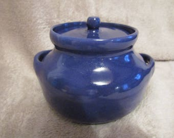 Candy, jewelry, secret box or even blue sugar bowl.