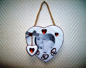 Hanging heart shaped photo frame