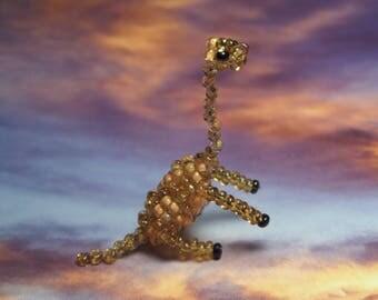 Miniature dinosaur Brachiosaurus, Brown and orange seed beads and nylon thread