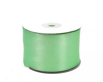 25 meters of 50 mm wide water ref 513 green satin ribbon