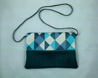 Suede clutch with shoulder strap
