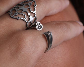 silver open ring.