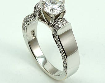 Engagement Ring 18K WG CZ Center Stone with 40-Diam Side Stones at 0.46 Cts.