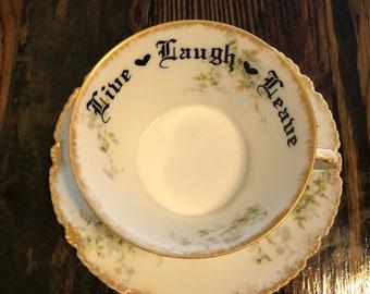 Live Laugh Leave | Vulgar Royal Halsey embellished vintage tea cup and saucer set.