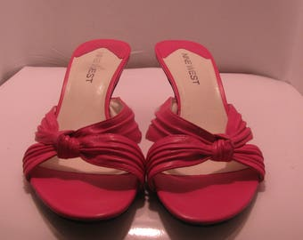 Women's slip on Pink 2-inch heel.  Pre-owned