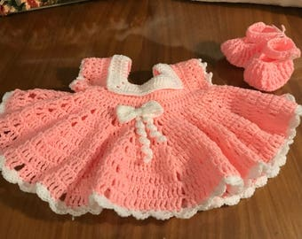 Pretty in pink baby dress and booties.