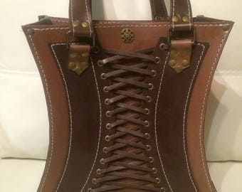 Leather bag in the shape of a corset