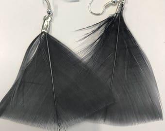 Feather earrings  in gray