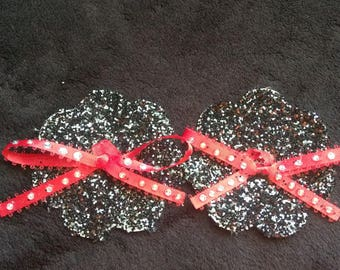 Shimmery black nipple pasty with red studded ribbon