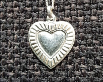 Heart-shaped pendant including silver necklace. Original 70s!