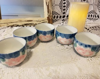 Pink and blue floral tea cups