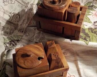 A pair of mid century olive wood cruet sets