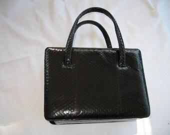 Snake-skin handbag glossy black.