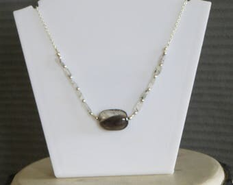 black and clear stone necklace