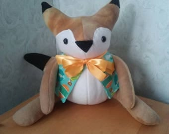 Fox in brown fleece. For all ages. Hypoallergenic stuffing. Safety lock eyes. Measures 18 long x 12 high x 13 wide. Hot air balloon vest.