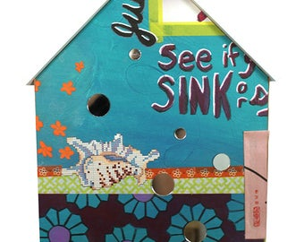 Sink or Swim - A Large Collage House
