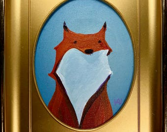 Original Painting of Red and White Fox on blue in a 5x6 repurposed oval vintage plastic gold frame