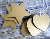 Black and gold chunky wood heart and star Christmas tree ornaments. Simple, minimalist, modern country, rustic decorations.