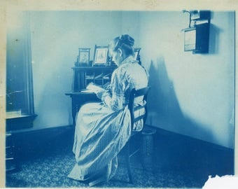 vintage photo 1900 Cyanotype Woman from Back Reading Blue Letter at Desk