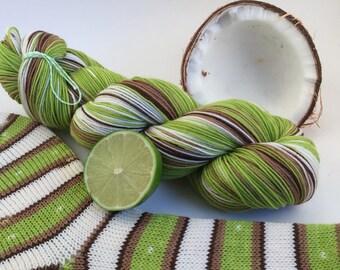 "hand dyed self striping sock yarn - ""Coconut Lime"""