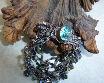 Handmade Bead Crochet Bracelet in Silvery Gray with Beautiful Peacock Colors of Beads in Purple, Pink, Blue, Green, Antique Button Closure