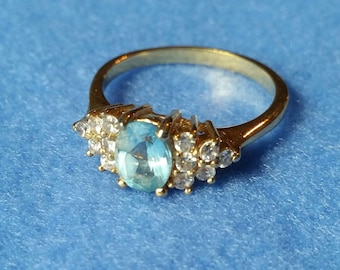 Vintage Gold Tone Ring with faux diamonds and faceted light blue stone, size 10.5, vintage ring