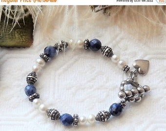 ChristmasInJulySALE..... SALE......One of a Kind Sterling Silver Faceted Lapis Lazuli and Genuine Pearl Bracelet