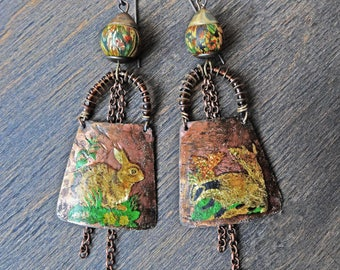 Artisan boho earrings in rust hues, salvaged tin with vintage decals, rabbit and badger